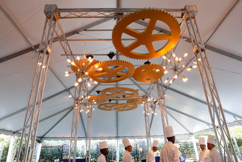 Gear and lights display above chef station on terrace