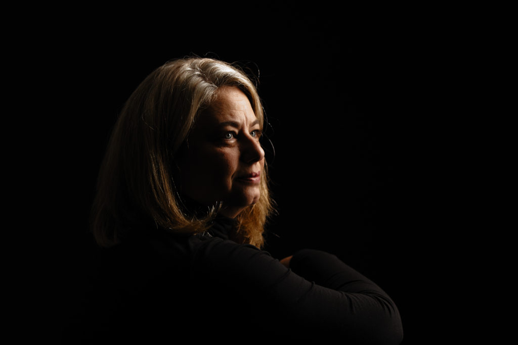 Woman's portrait on black with dramatic lighting