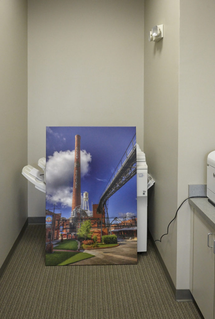 Large canvas of American Tobacco Campus waiting to be hung above copier