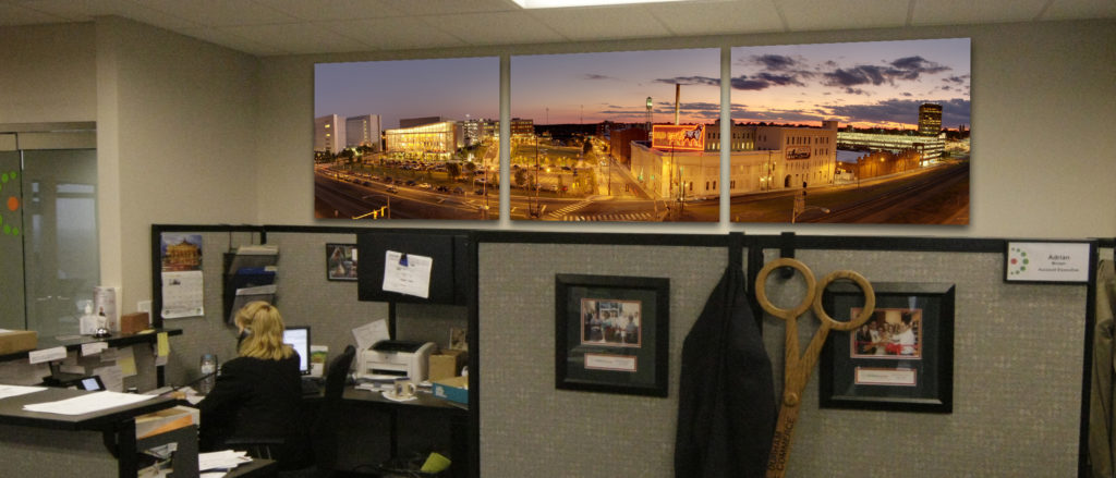 Cityscape of downtown Durham on 3 canvases above front desk of Chamber of Commerce